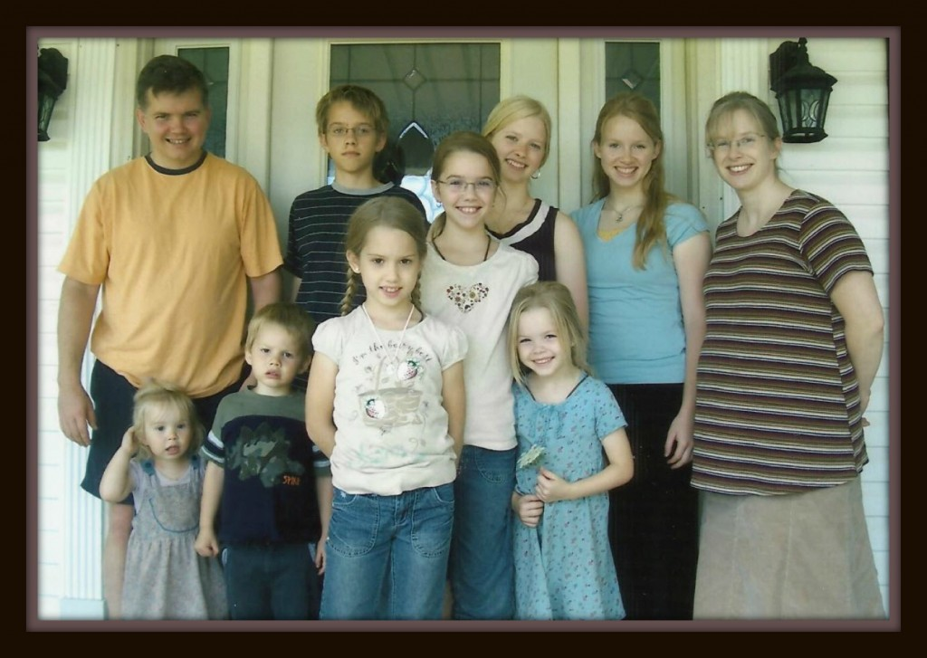 Daphne with her family when she was pregnant with number nine.